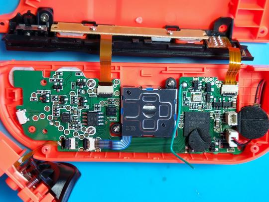 The PCB inside the red controller